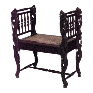 Asian Burmese Style Carved Walnut Bench with Carved Spindle Side Arms and Cane Seat For Sale