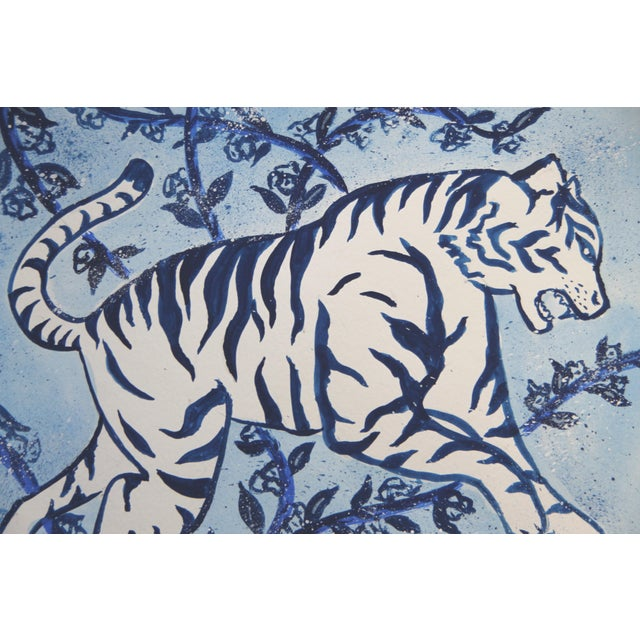 A wild white tiger in shades of indigo blue, inspired by Chinese paintings, on a mottled botanical background with vines...