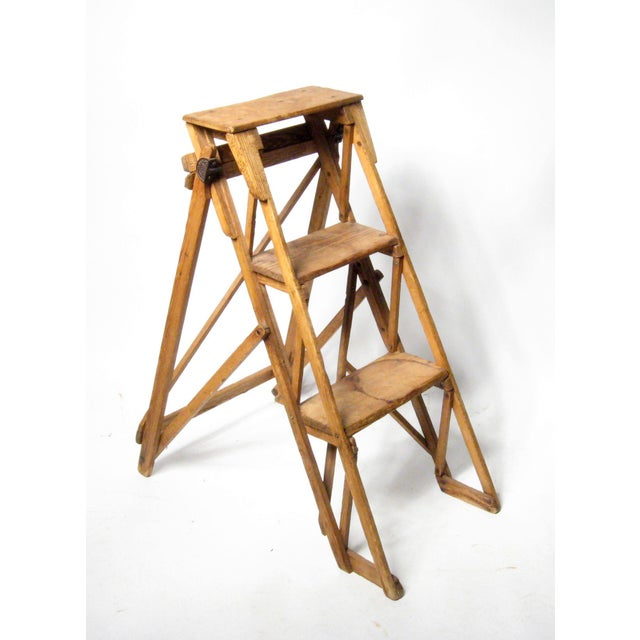 19th Century utilitarian step ladder from England. Beautiful patina with overall wear. A great accent piece for display,...