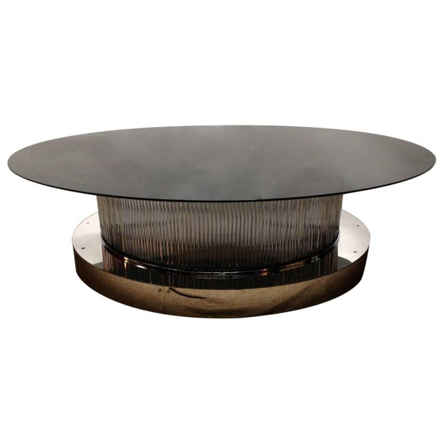 One of a kind Italian over sized crystal bars coffee table with chrome base and glass top. This table can be lit up from...
