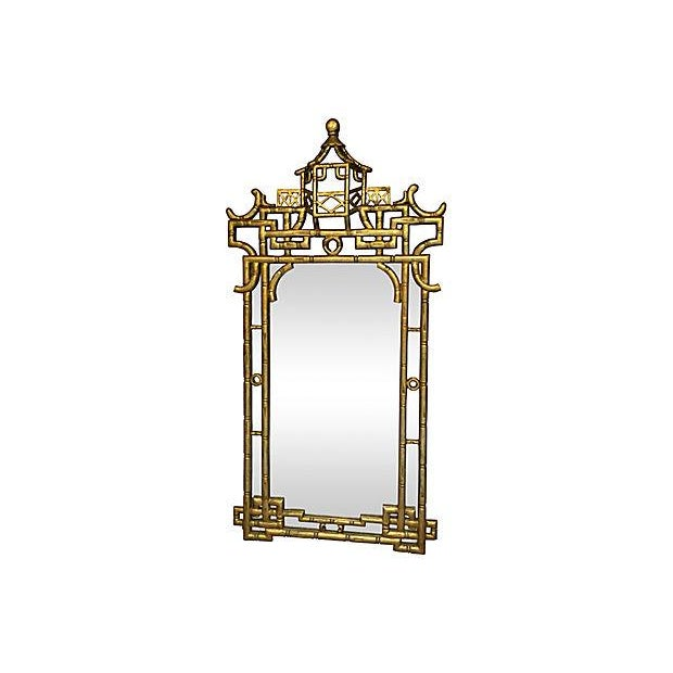 This is a custom-made mirror with an ornate faux-bamboo giltwood frame.
