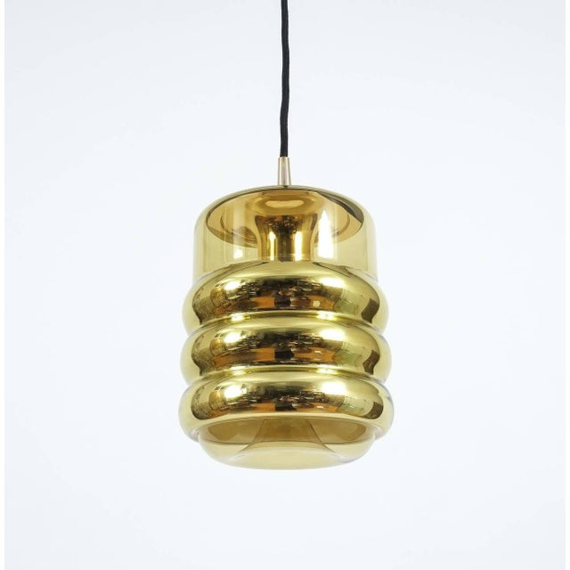 Nice glass pendant by Staff or Germany featuring slightly yellowish glass with a golden metallized mirror effect. Each...