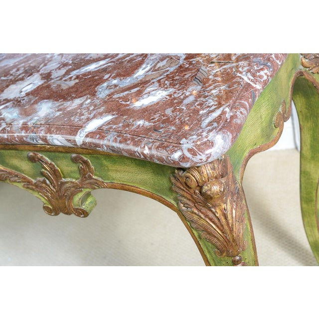 This late 19th. C. French Painted console table is made of solid carved Oak wood and has a beautiful, Green color and...