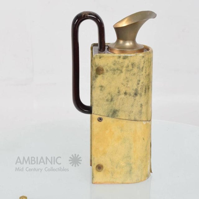 For your consideration a vintage Aldo Tura pitcher. Sculptural shape. Very unusual construction with wood handle and brass...