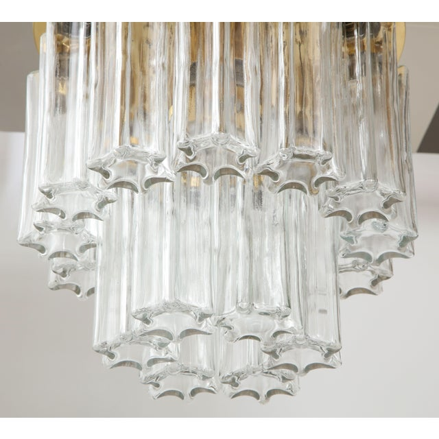 1960s flush mount ceiling fixture by Doria lighting company. The textured star shaped glass tubes hook on to the polished...