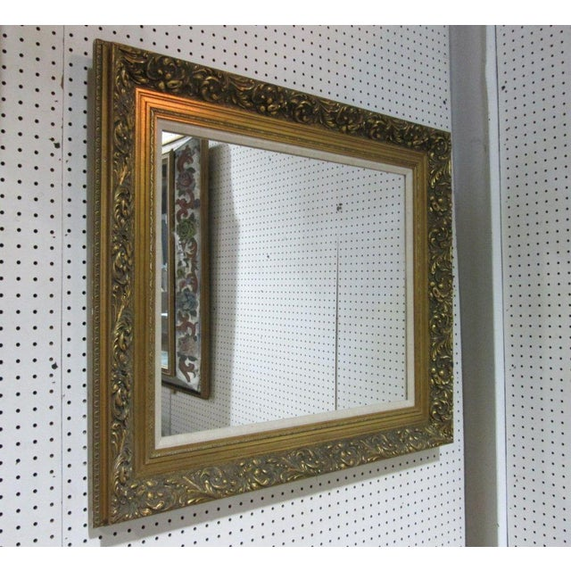 Has a lovely decorative gold frame.