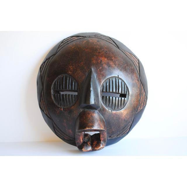 Vintage hand carved African mask. Made in Ghana. Beautiful styling for your wall, console and mantle!