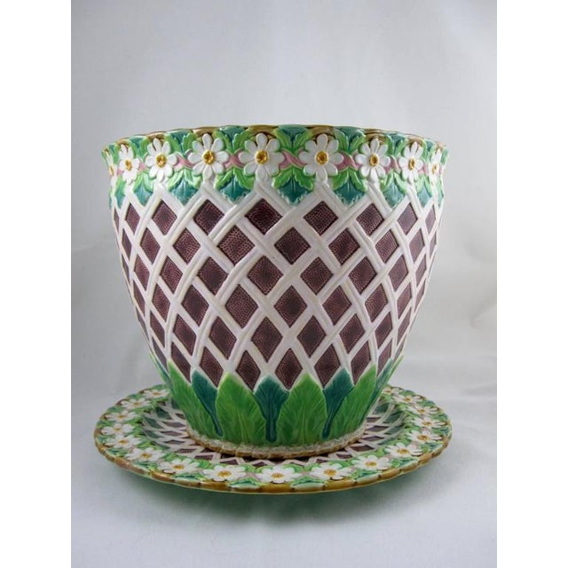An excellent quality Minton majolica 'Daisy and Trellis' Jardinière on stand, England, circa 1875. The jardinière is...