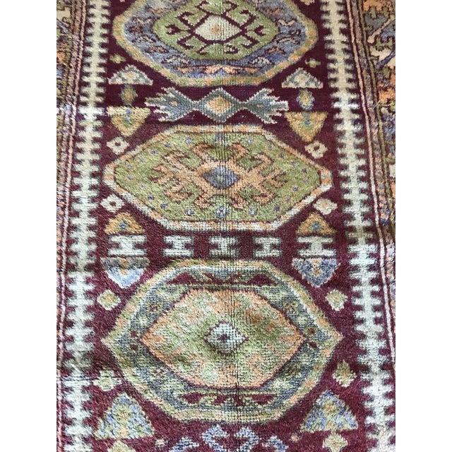 Vintage Turkish rug with rich crimson and apple-green