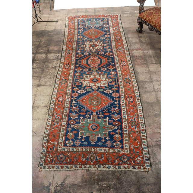 Antique Caucasian Kazak Runner with tribal design. c. 1900s. Size: 12x4 feet.