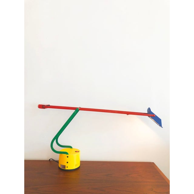 Rare Memphis style colorful 1980s halogen table lamp. Weighted end to balance at different positions. Enameled metal and...