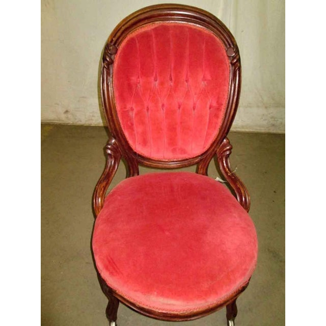 Elegant tufted upholstered back parlor chair. The frame is carved wood, most likely walnut and the seat velvet has some...