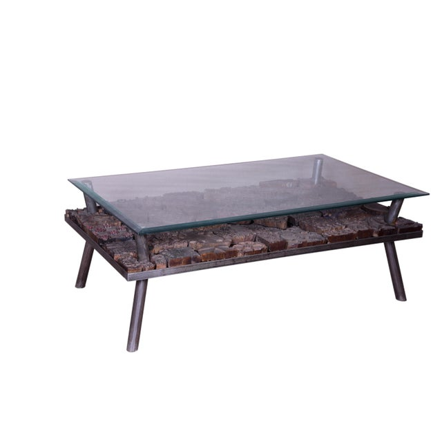 Sleek and contemporary, this coffee table is the perfect addition to any modern space. The tempered glass looking upon the...