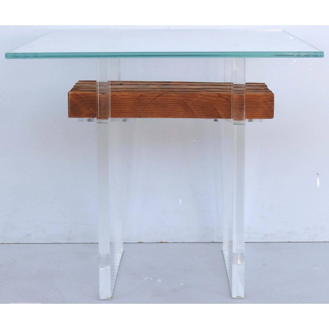 Lucite, Wood and Glass Side Table Offered for sale is a bespoke Lucite, wood and glass side table. The base floats a...
