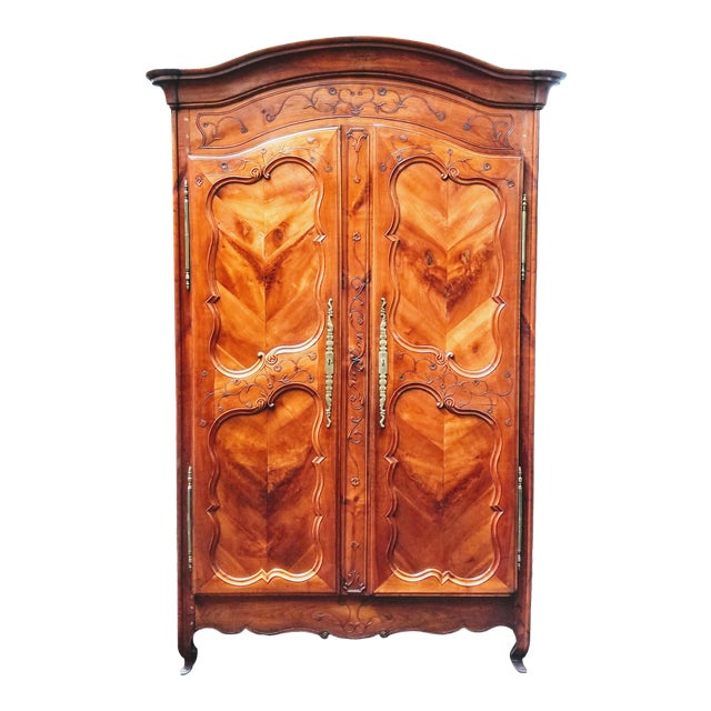 18th Century Louis XV French Armoire De Mariage With Carved Flower Accents Cherry Wood For Sale
