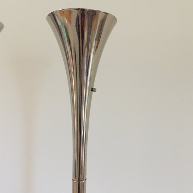 Striking Pair of original Mid Century Modern tall sophisticated floor lamps elongated and shaped like a horn /tulip at the...