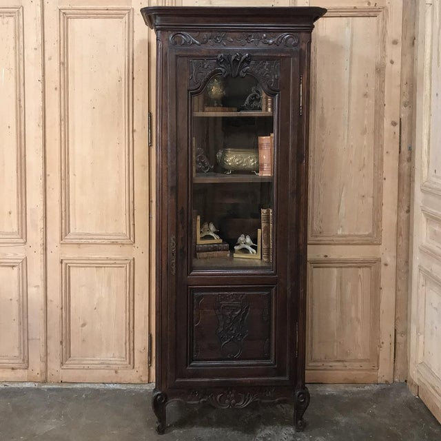 18th Century Country French Provincial Vitrine is the ideal piece to display a special collection or family heirlooms, and...