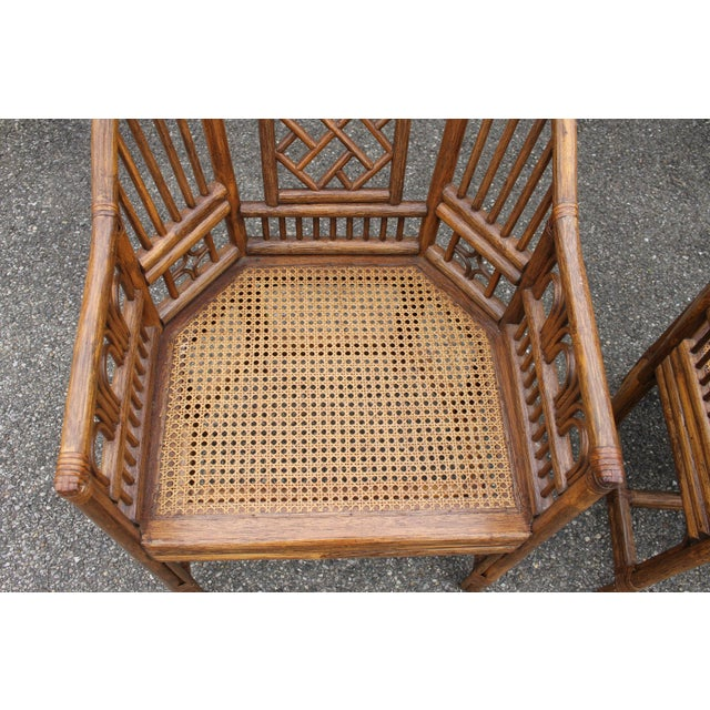 Exotic set of chinoiserie bent bamboo chairs. Bamboo is absolutely beautiful and in fantastic condition. Chairs are...