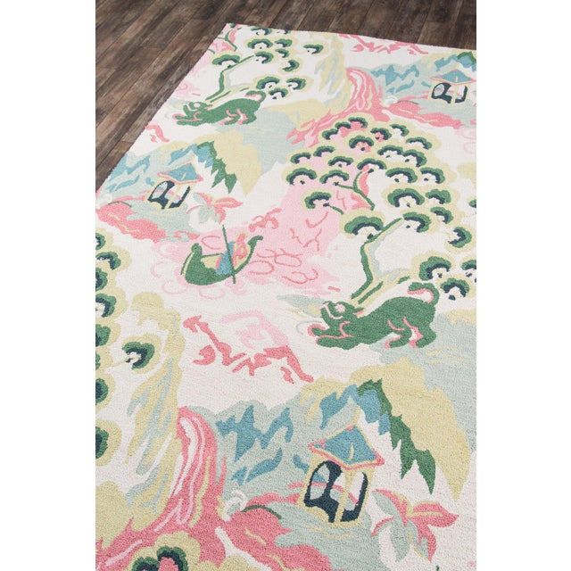 Tiptoe across the toile pattern of this traditional area rug that's resplendent in its Far East finery. Hand-tufted cotton...