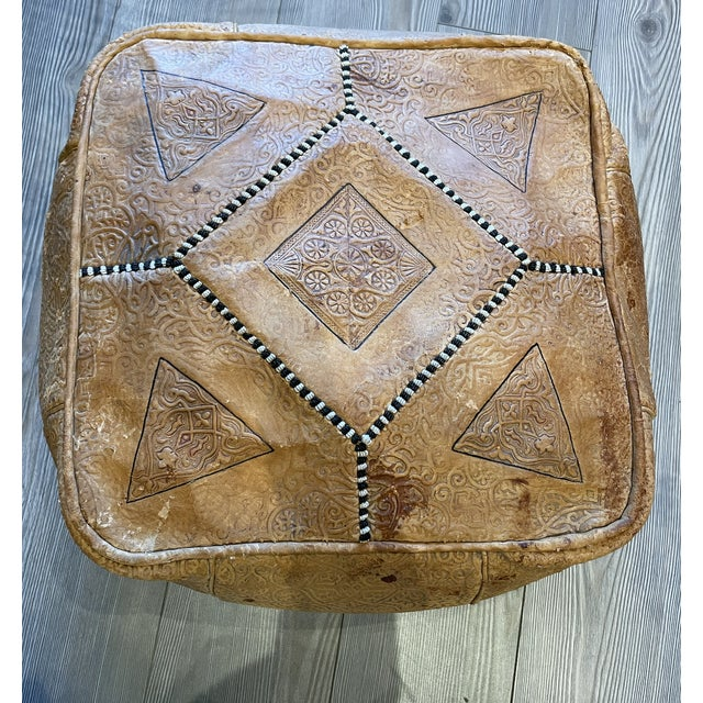 Sewn patchwork leather poof from Turkey with black and white stripe stitching. The leather has developed depth and...