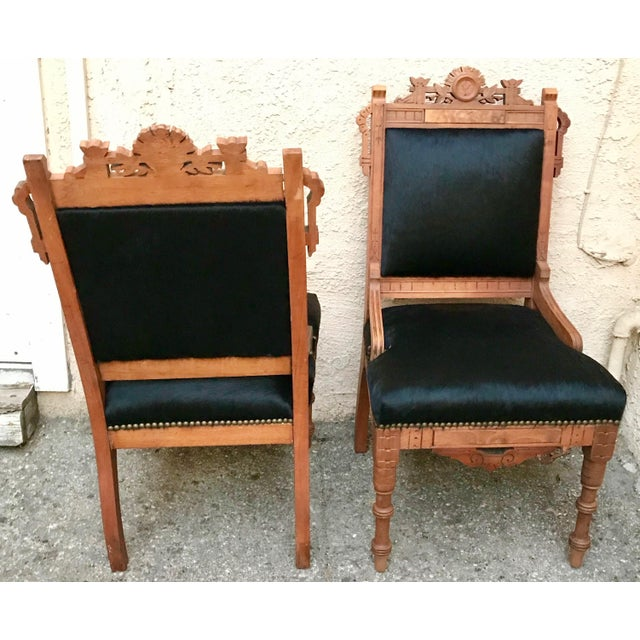 One of a kind antique throne chairs recovered in hight quality ebony color hair on hide. Natural oak hand carved details...