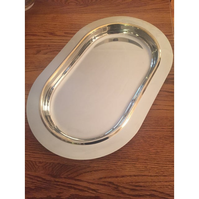This tray by Morinox was produced in the 1950s using 18 /10 Stainless Steel. It is designed with a rim with gold...