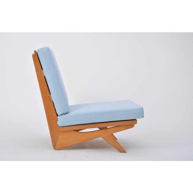 This chair was designed by Georg Thams in 1964 and produced by AS Vejen Møbelfabrik in Denmark. It is from the same series...