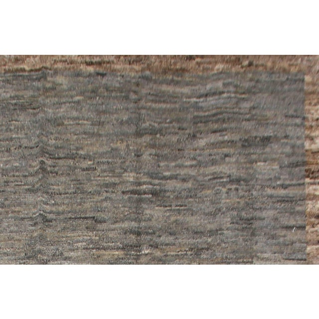 Hand-knotted Moroccan rug made by Aara Rugs Inc. This stunning rug is made of 75% wool & 25% cotton, dyed with pigment...