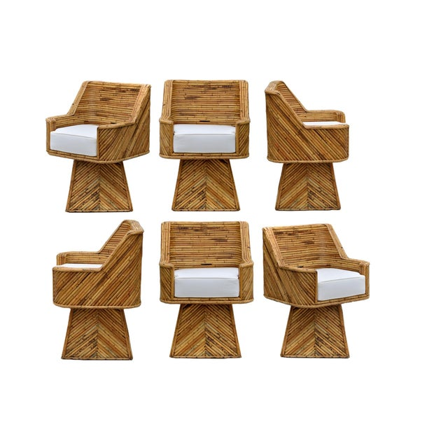 An exceptional and rare set of bamboo reeded swivel chairs in the strong manner of Gabriella Crespi. The early 1970's...