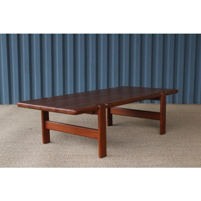 1960s Danish modern coffee table constructed in solid teak. Recently refinished and in excellent condition.