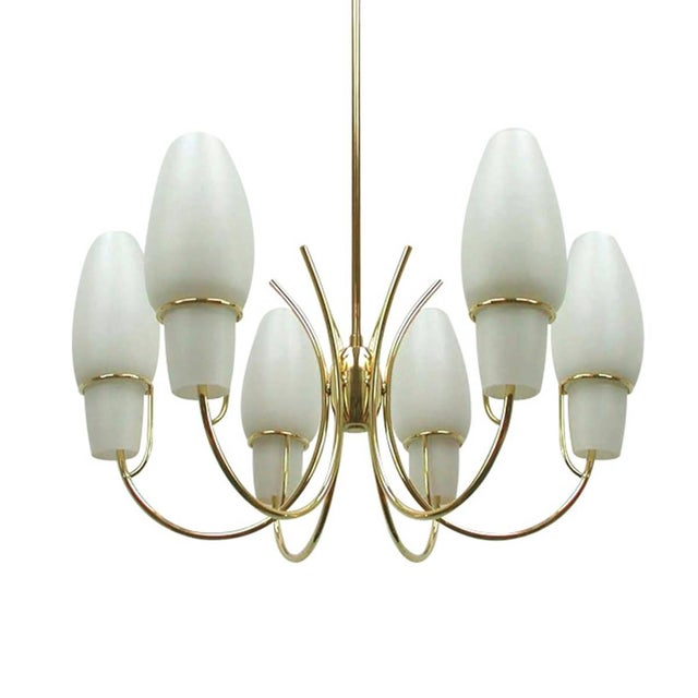 1950s Italy , Mid-Century Modern brass chandelier features six opaline glass shades in perfect condition. Extraordinary in...