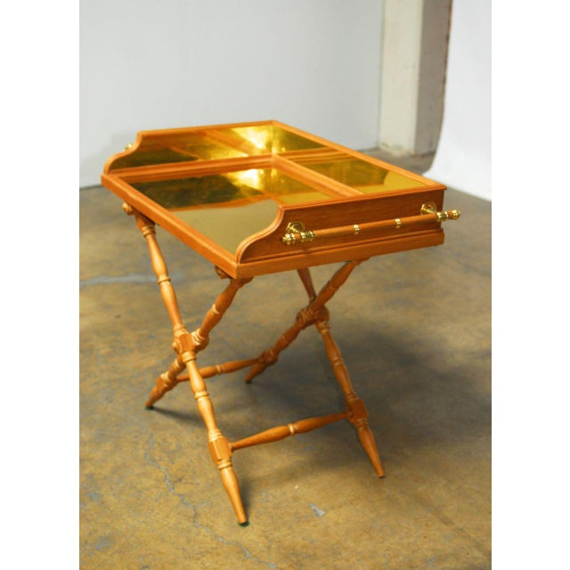 Butler's tray table featuring an oversized removable serving tray lined with brass and galleried sides. Made of Italian...