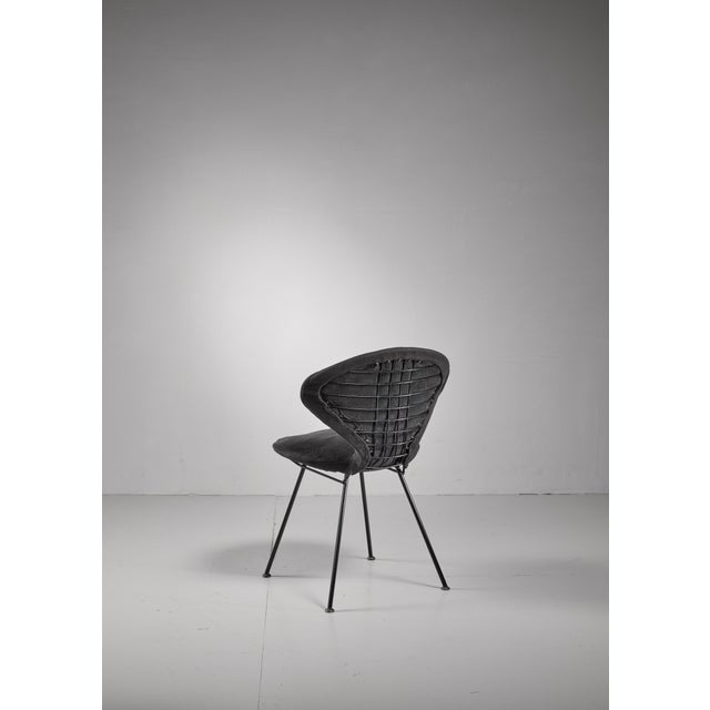 A Rima side chair atrributed to Gastone Rinaldi. The chair is made of a black metal wire frame with a black fabric...
