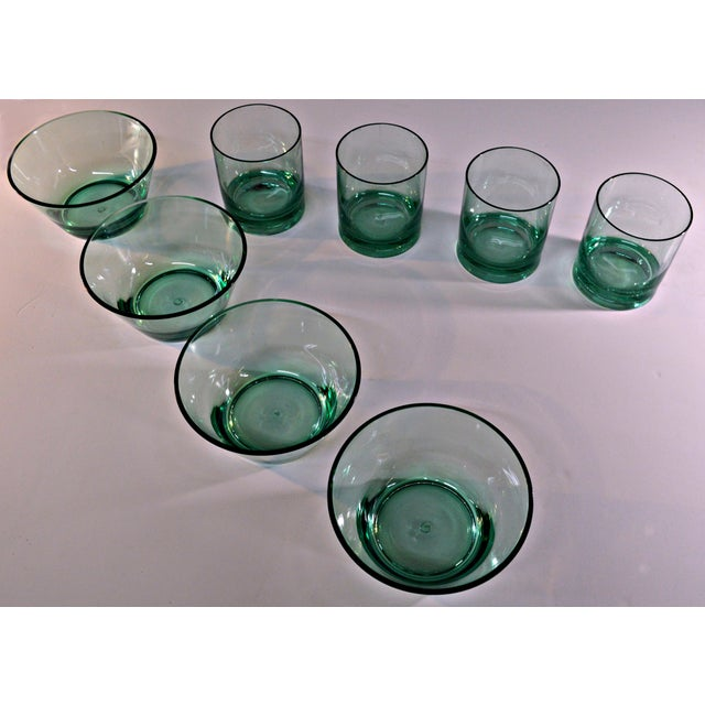 Defined geometric lines characterize this cozy set for 4, consisting of short cylindrical glasses and conical bowls for...