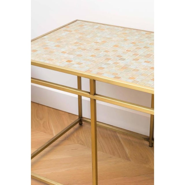 Beautiful brass console table with a glass tile-top.