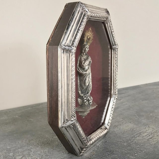 19th Century Madonna in Octagonal Frame features a silvered figure atop angels situated on a three-sided corbel, with a...