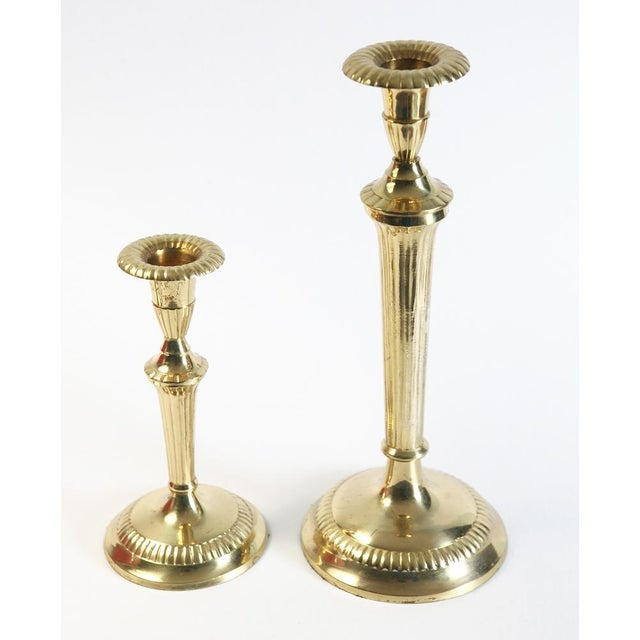 These vintage brass candle holders have a beautifully scalloped rim. The brass is thin not heavy. Some age wear. Great for...