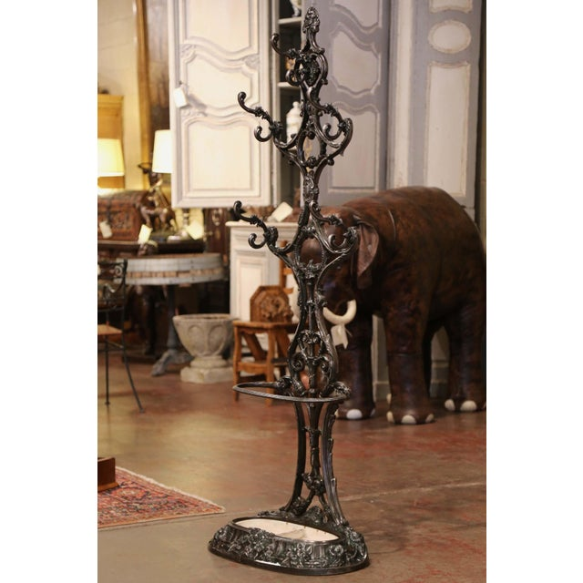 Place this elegant antique hall tree in an entry or a mud room to catch coats, and umbrellas. Crafted in France circa...