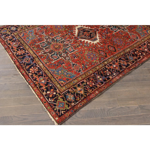 Vintage hand-knotted Persian rug with a medallion design on an orange field, this rug has a great color scheme and is...