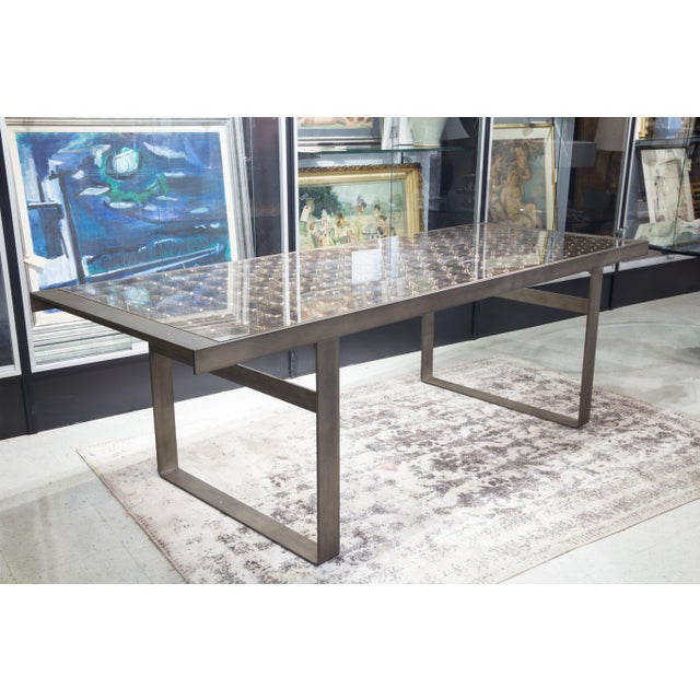 The artist, Patricia Urquiola used lenticular treated glass to create a unique illusion of depth. Dining table mounted on...