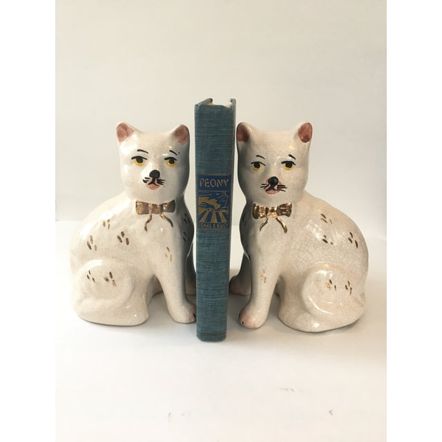 "Wonderful set of Staffordshire cats that would look great in any kind of decor. Each cat measures 8"" tall and 6"" wide...."