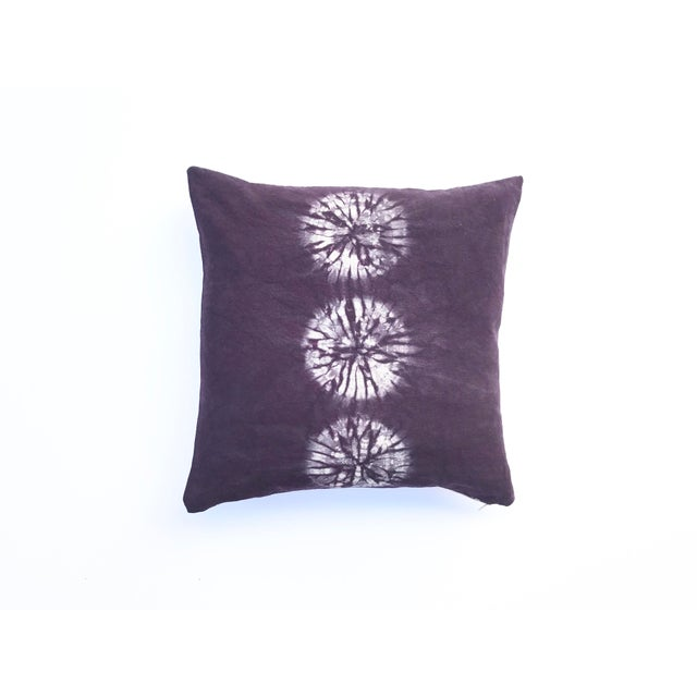 Eggplant or Aubergine throw pillow with circles design. The pattern was created using the nui shibori technique of hand...