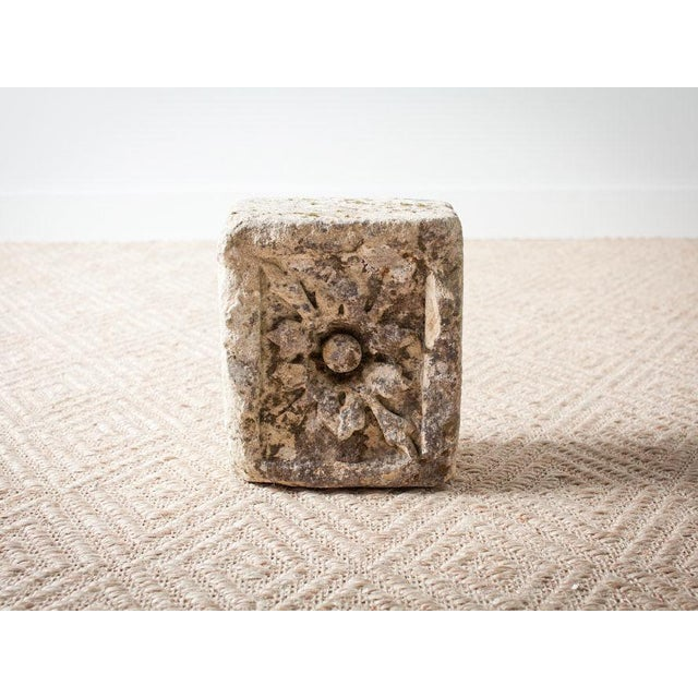 This is a vintage stone architectural fragment from the 1990s. The piece features a flower detail and moss patina.