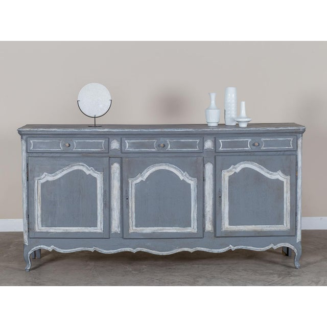 This handsome antique French oak buffet circa 1875 features a wonderful painted finish applied to take advantage of the...