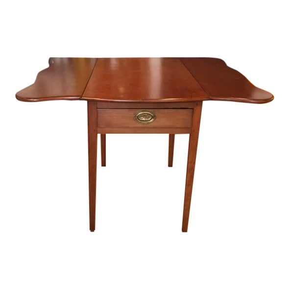 Cherry serpentine edged drop leaf Pembroke or breakfast table. Extremely usable table for cards, meals, or simply as a...