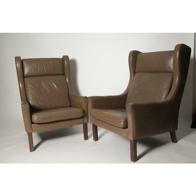 Borge Mogensen attributed wing back club chairs- mid 60's. re covered early 80's in mocha leather. a great pair of chairs...