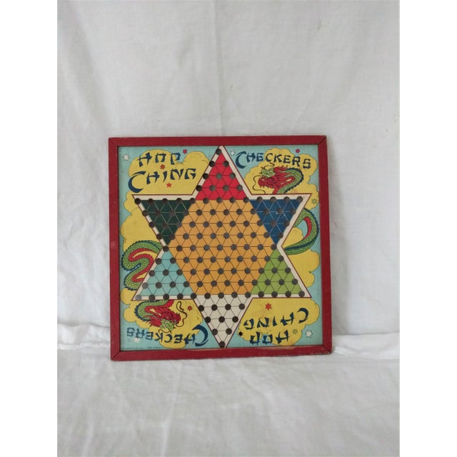 Made from a pressed board and wood trim this colorful game board with dragons makes a spectacular wall accent piece....