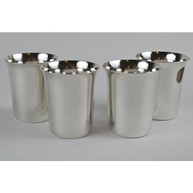 Set of 4 20th century sterling silver shot glasses by Manchester Silver Company, with Crown mark. This sleek set of shot...