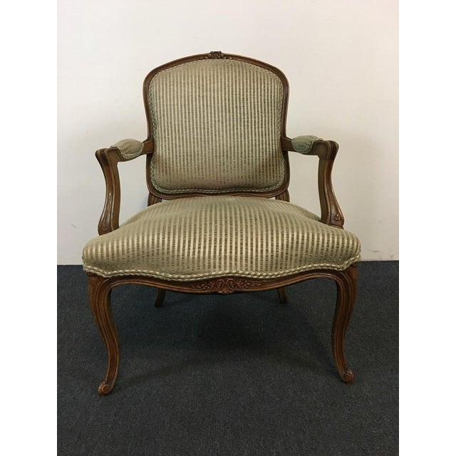 Lend comfort and style to a living room or bedroom with this beautiful B&B Interiors Upholstered Library Armchair....