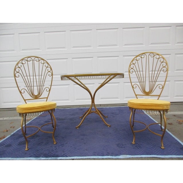 Here's a beautiful bistro or patio set by Thinline of Santa Ana, California. This set includes a gilt metal glass top...